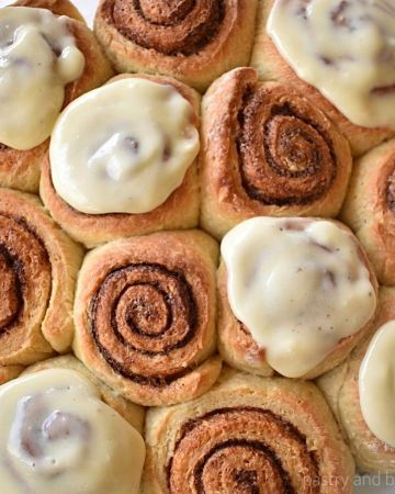 Cinnamon rolls with some of them iced on top.