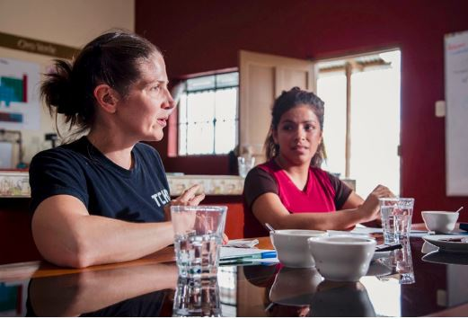 TCHO Source Manager, Laura Sweitzer, tastes cacao liquor with Oro Verde Production Manager, Karen Gisella Macuado