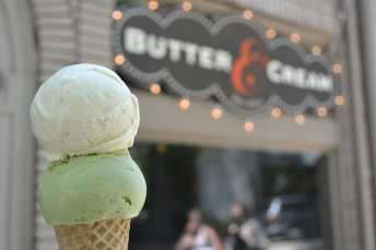 Double Scoop of Lemon Custard and Green Tea Ginger on a sugar cone