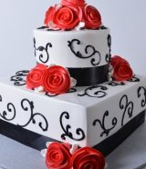 square and round with black scrolls and red flower wedding cake