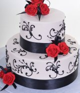 black scrolls with red flower wedding cake