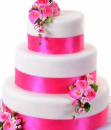 Pink ribbon with pink flowers wedding cake