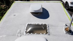 Applying Dicor Cool Coat to the roof of our travel trailer