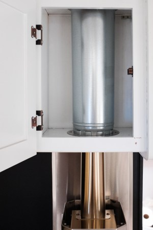 "The double walled pipe is cut to fit, and floating around the 3"" stove pipe inside, protecting the cabinet from overheating."
