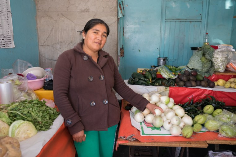 Gabriela Gonzalez Lopez sells fresh produce and chickens at a crossroads near her farm in Ixmiquilpan.