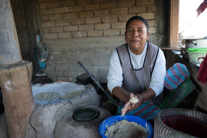 Margarita Gomez, tortillas, El Rosario, southeast of Oaxaca in a roadside stand, Working with wood fire and comal, she makes handmade tortillas in a very traditional way.