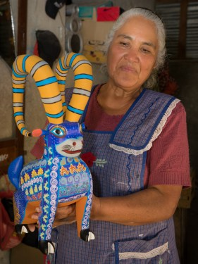 Jesús Jimenez Hernandez shows an alebrije she painted.