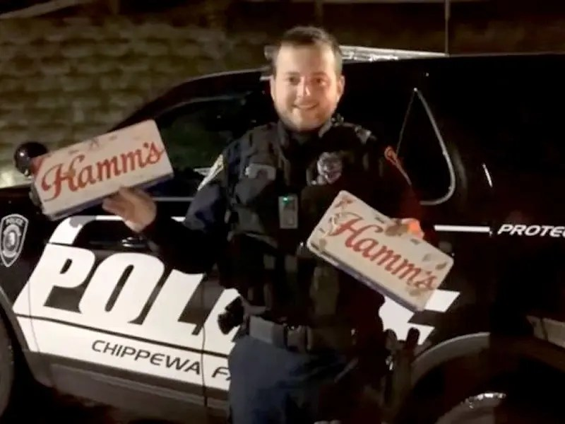 In the video, Chippewa Falls Police officer Scott Schoenwetter is shown standing in front of his police cruiser.