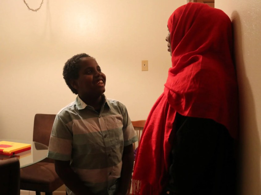 Nedifo Halane, right, stands near her kitchen of her Phoenix apartment with her son, Abdirezak Abdi. They are refugees from Somalia, and have waited for more than two years for the rest of their family to join them.