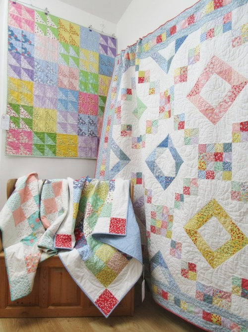 Quilts in the lobby by Allison Reid