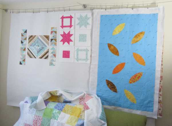 Four WIPs on the design wall by Allison Reid