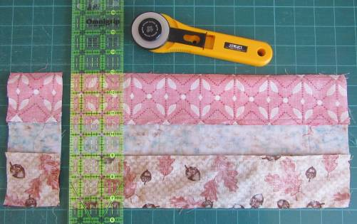 Cutting the scrappy strip set tube by Allison Reid