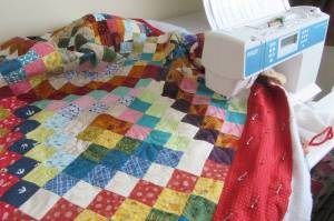 Scrappy Trip Along quilting in progress by Allison Reid