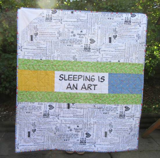 Snoopy Baby Quilt finished back by Allison Reid
