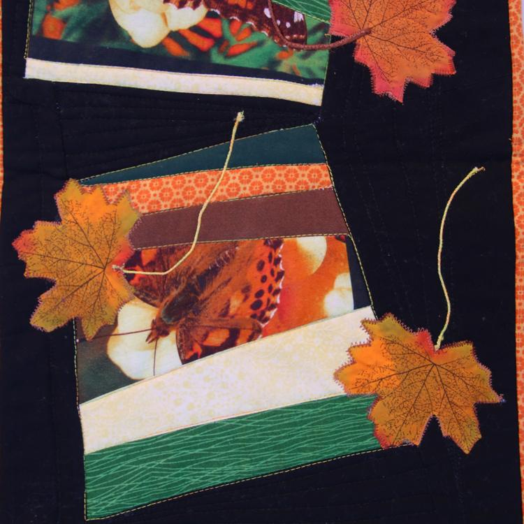 foto de mariposa, telas lisas y estampados pequeños en patchwork improvisado