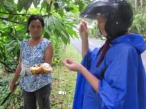 A lady offers Nina cacao