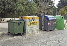 Contenedores de reciclaje ubicados en la calle 218