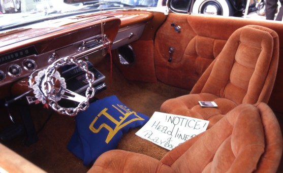 Chrome chain lowrider steering wheel and velour interior
