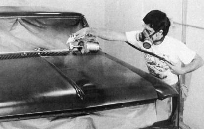 John Harvey painting Reggie Jackson's '66 Chevy Nova SS