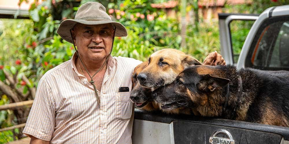 Rene Contreras and his dogs on Finca Monte Verde.