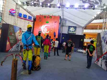Kailas Outdoor Gear putting on a marketing show complete with a climbing wall.
