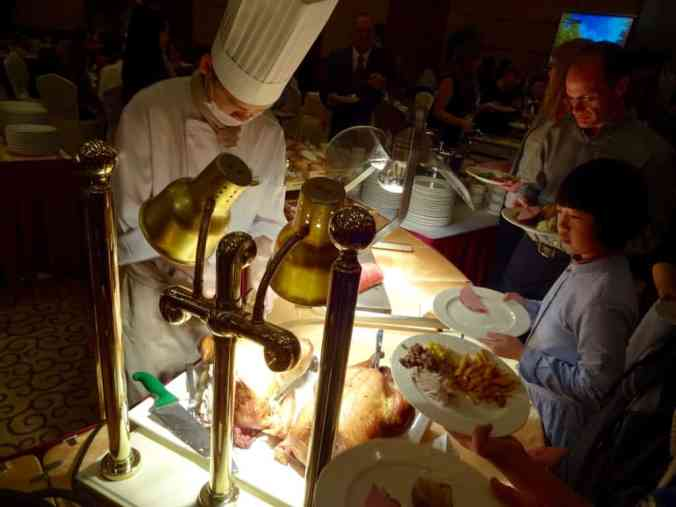 The chefs carving the turkey.