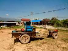Laotian trucks: a lawnmower engine attached to a trailer which holds cargo and passengers. They move about 5 kph.