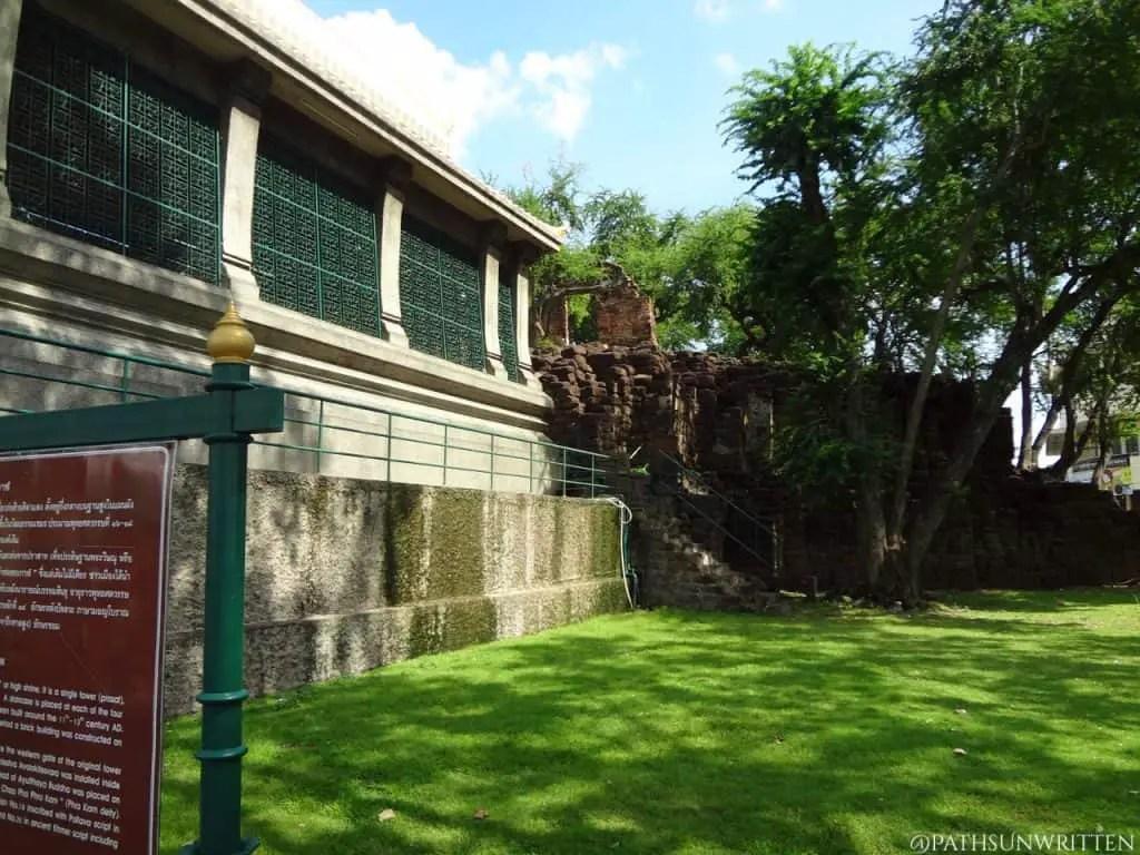 The Khmer monument behind the modern shrine.
