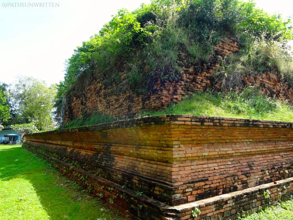 The base of a massive stupa behind the wiharn.