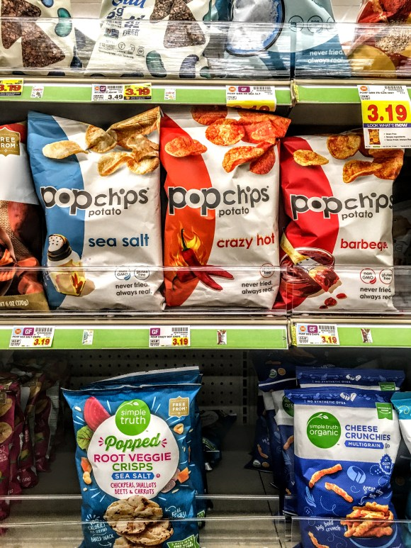 A store shelf displaying bags of Crazy Hot Popchips.