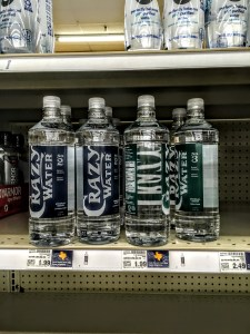 Bottles of Crazy Water stacked on store shelf
