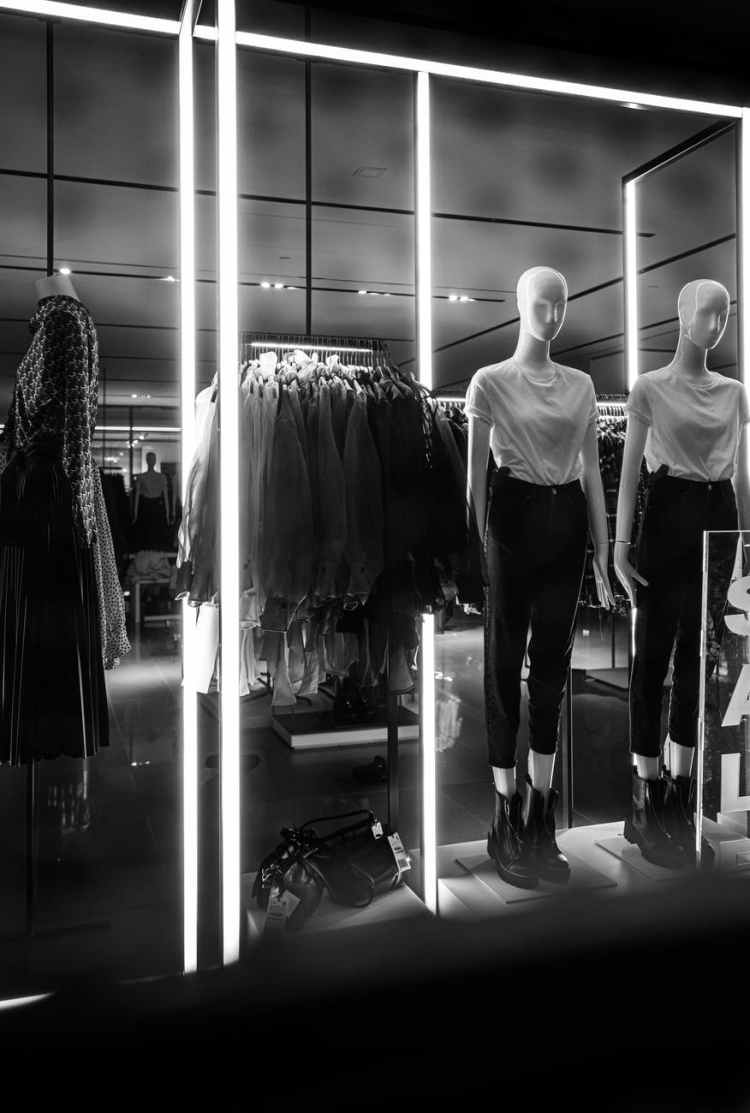 grayscale photography of mannequins