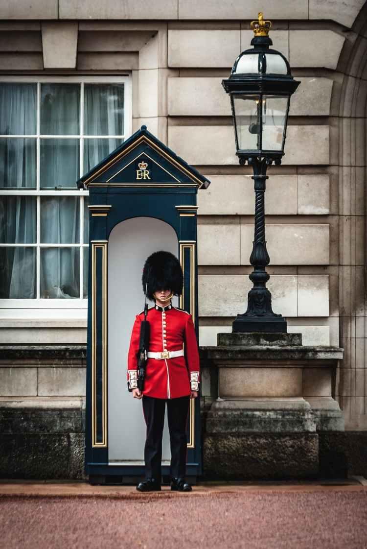 royal guard standing near lamp post