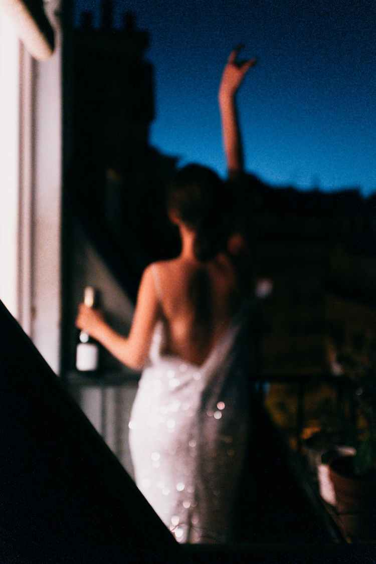 photo of woman holding bottle