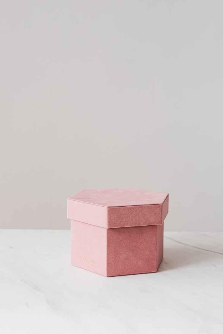 pink carton gift box on table