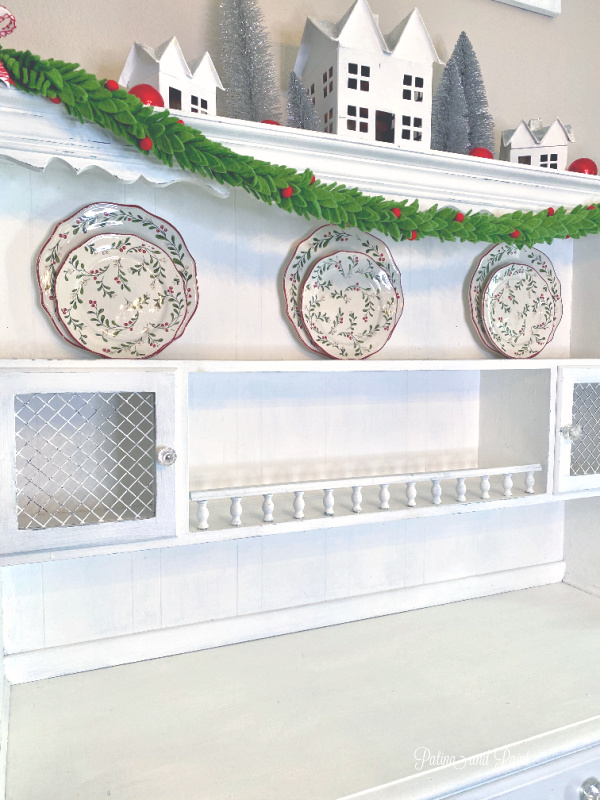 Christmas plates, white hutch