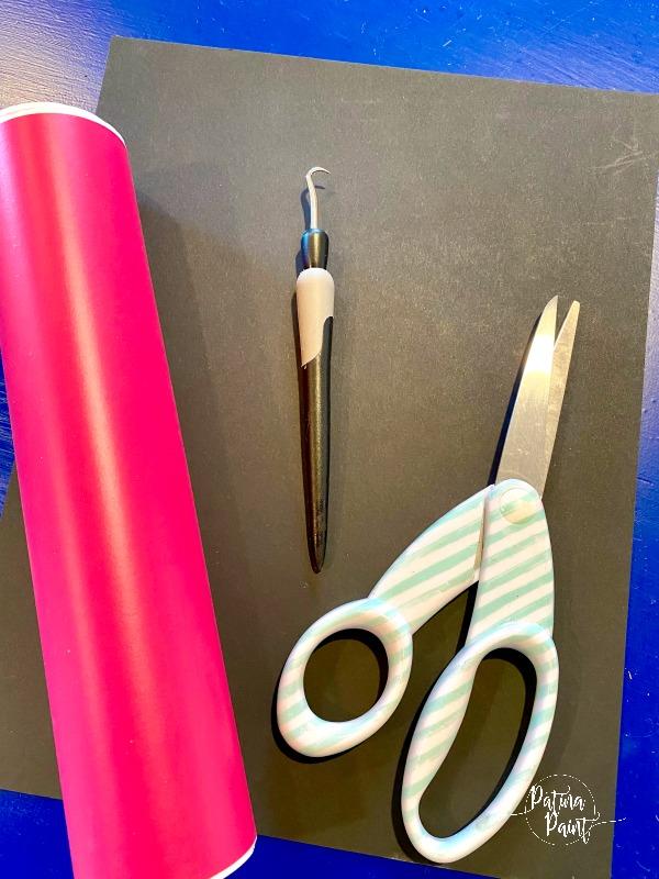 vinyl, tools, scissors, black yardstick