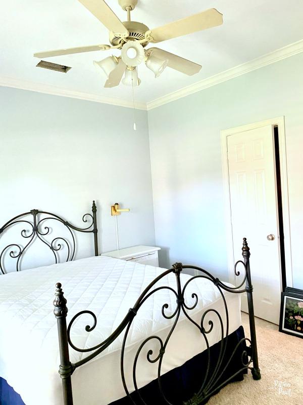 Iron bed, gray walls