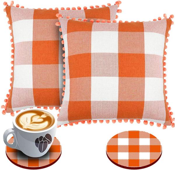 orang and white pom pillows