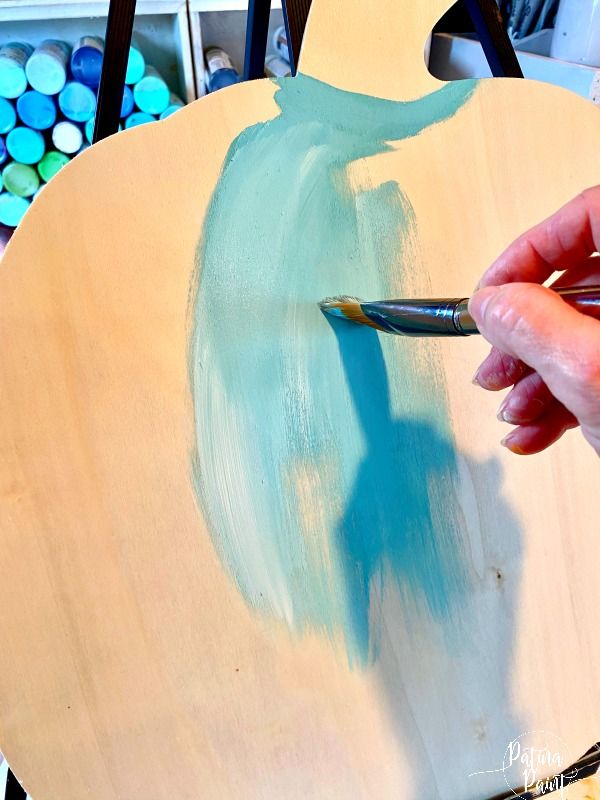 painting a wooden pumpkin turquoise