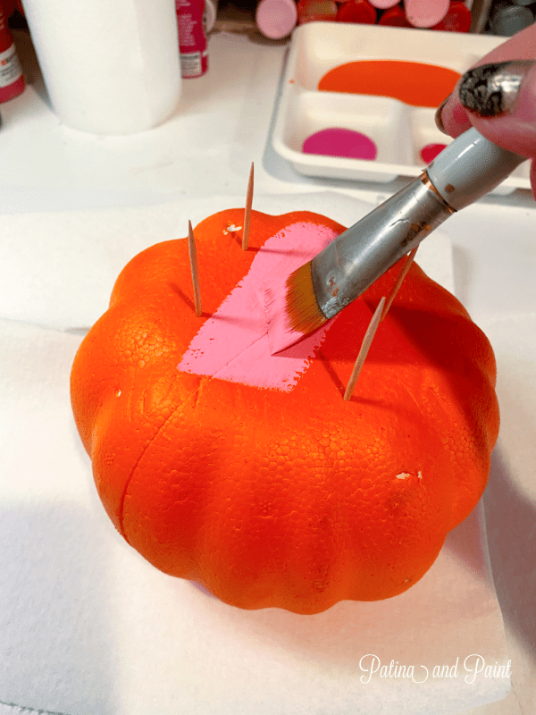 adding toothpicks and painting a pumpkin