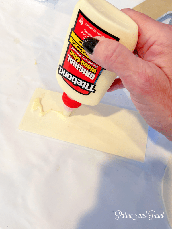 adding glue to a piece of wood