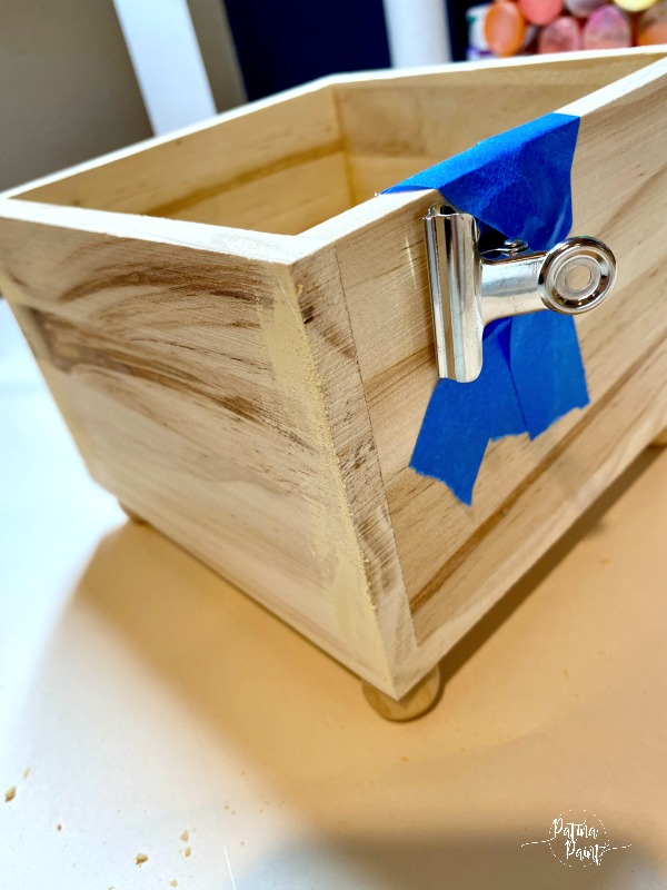 wooden box with metal clip
