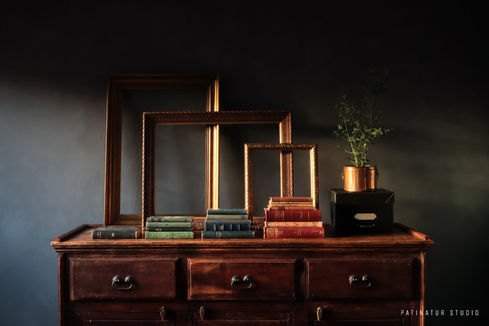 Photo Art | Dark and moody still life with vintage books and frames