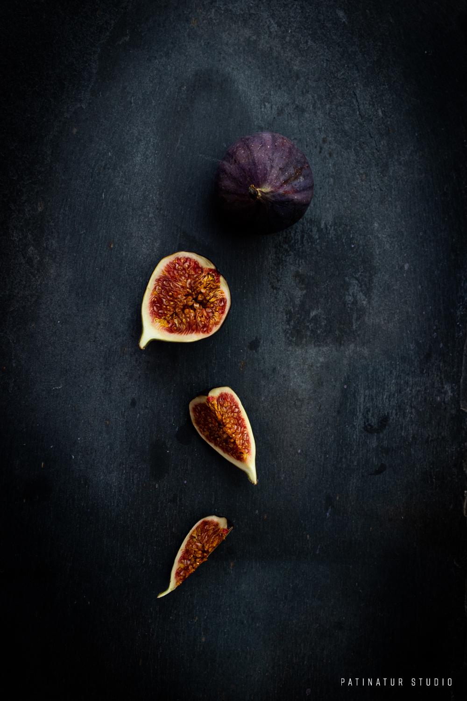 Photo Art | Dark and moody flatlay with sliced fig