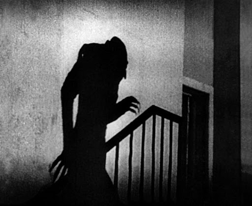 Still photo from 'Nosferatu'. Example of chiaroscuro lighting in German Expressionist films.