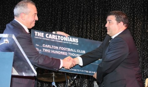 Carltonian President Vince Loccisano giving Carlton Football Club President Mark LoGuidice with this years donation.