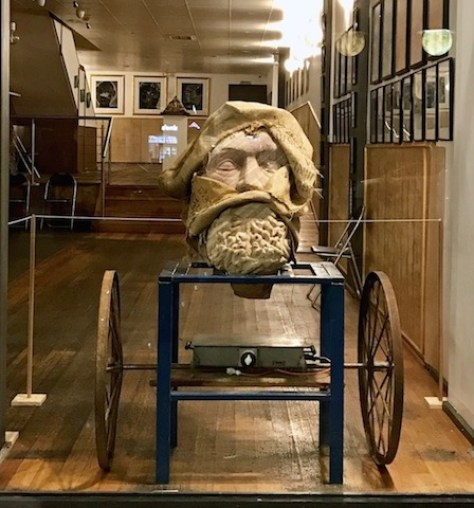 Adrian Spurr. The second manifestation of Zeus, 'The Pariah', Sandstone, Steel table and Chariot wheels, 2018.