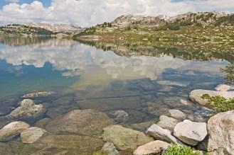 wind river island lake cloud reflections w rocks