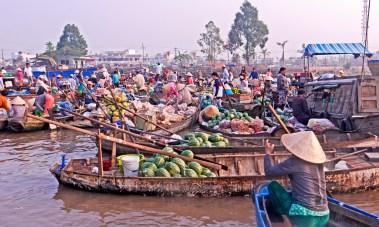 Cantho Vietnam floating market sunrise building